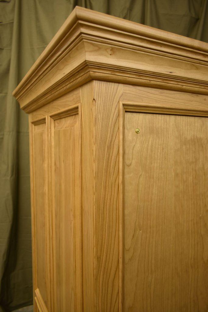 Accordion cherry cabinet detail